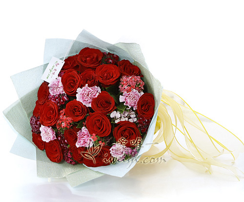 bouquet of red roses and pink carnations