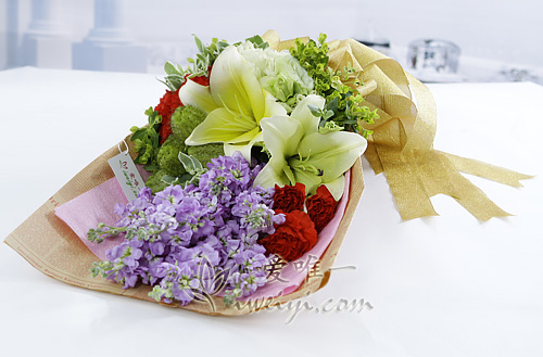 bouquet of yellow lilies, light purple matthiola incana and red carnations