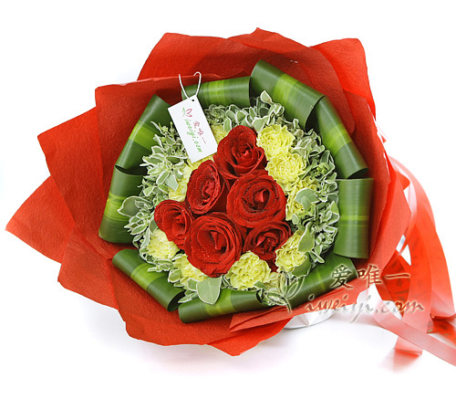 bouquet of  red roses and yellow carnations