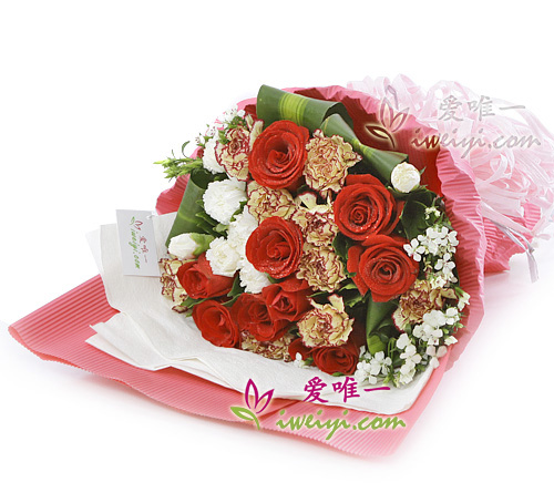 bouquet of red roses and multicolor carnations