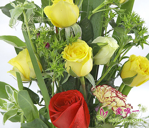 vase of red roses, yellow roses and yellow carnations