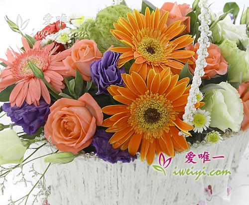 basket of 6 pink roses, 2 pink gerberas, 2 orange gerberas and lisianthus