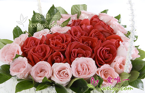 basket of flowers with red roses and pink rose